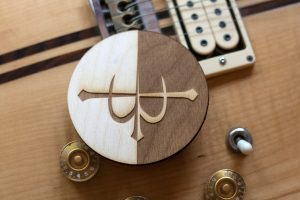 Trinity & Triage logo laser engraved on wood